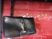 【Yves Saint Laurent/イブ・サンローラン】のラウンドジップ財布入荷いたしました!!